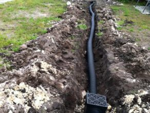Setting up new drainage system on back yard