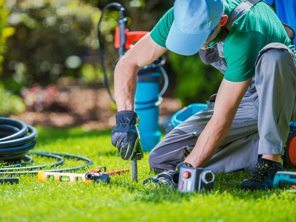 Professional installing an irrigation system